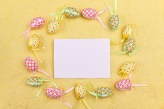 Easter greeting card and colorful eggs on a yellow background. Copy space. Easter greeting card and colorful eggs on a bright yellow background. Copy space for royalty free stock photography