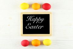 Easter greeting card concept. Festive composition on wooden background stock photos
