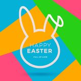 Easter greeting card. Cut from paper silhouette of a rabbit`s head with Easter greeting on a abstract background. Easter greeting card. Cut from paper silhouette Royalty Free Stock Images