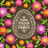 Easter greeting card - Decorative Easter egg  with greeting  and  paper flowers. On a wooden background Stock Image