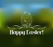 Easter greeting card with decorative egg on a blurred background Royalty Free Stock Photo