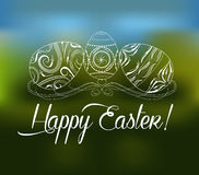 Easter greeting card with decorative egg on a blurred background Royalty Free Stock Photos