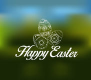 Easter greeting card with decorative egg on a blurred background Stock Image