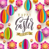Easter greeting card - Easter brush calligraphy greeting, flowers and eggs background. Royalty Free Stock Photo