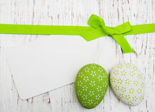 Easter greeting card with easter eggs. On a old wooden background Stock Photography
