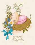 Easter greeting card with egg, flowers on beige background. Stock Photo
