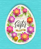 Easter greeting card - egg-shaped paper banner with floral frame and greeting on a wooden background. Vector illustra. Easter greeting card - egg-shaped paper Stock Image
