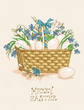 Easter greeting card with eggs in a backet, flowers on beige background. Royalty Free Stock Photography