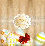 Easter greeting card with eggs, lace and banner on wooden backgr Royalty Free Stock Photo