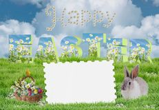 Easter greeting card with easter eggs and spring flowers in the basket and baby bunny. Text Happy Easter on blue sky background, colourful easter eggs with Royalty Free Stock Photography