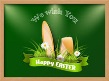 Easter greeting card with fresh grass and ears of bunny Royalty Free Stock Photos