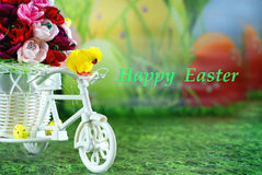 Easter greeting card with happy easter, chick on a bike with Easter eggs. Stock Photography