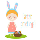Easter greeting card, seasonal background. Cute smiling girl with bunny ears and eggs in basket Stock Photo