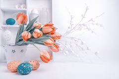 Easter greeting design with bunch of tulips and painted eggs Stock Images