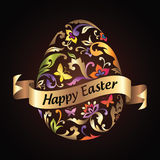 Easter greeting egg with flower pattern and gold ribbon tag. Decorative Easter egg with floral ornate pattern and golden ribbon banner with greeting text Royalty Free Stock Images