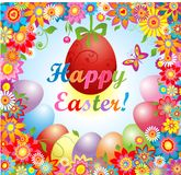 Easter greeting with flowers and hanging egg Stock Photography