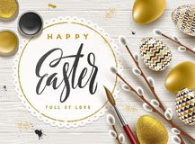 Easter greeting illustration. Pussy-willow branches, paint decorated eggs and paper frame with brush calligraphy greeting. On a wooden desktop Stock Images