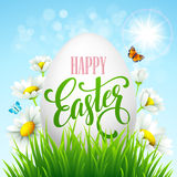 Easter greeting lettering. Eggs and flowers. Vector illustration Stock Photo