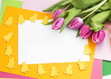 Easter greeting with tulips and Easter chicken decorations Stock Photo