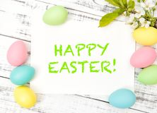 Easter greetings card colored eggs decoration spring flowers. Easter greetings card, eggs decoration with spring flowers. Pastel colored eggs royalty free stock images