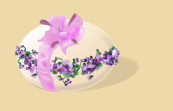 Easter greetings card with egg and violets Royalty Free Stock Image