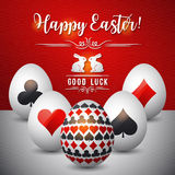 Easter greetings card with red and black symbols over white eggs Royalty Free Stock Photography