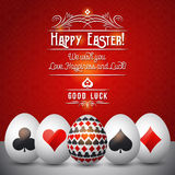 Easter greetings card with red and black symbols over white eggs Stock Image