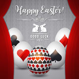 Easter greetings card with red curtain gambling symbols over whi Stock Images