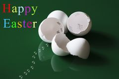 Easter greetings with shattered eggshells Stock Photo