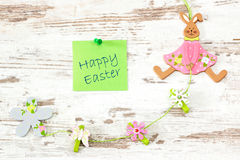 Easter greetings on wooden background Royalty Free Stock Photography