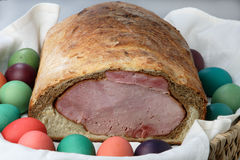Easter ham on bread with colored eggs Royalty Free Stock Image