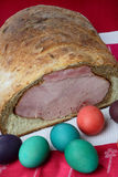 Easter ham on bread with colored eggs Royalty Free Stock Photos