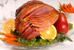 Easter ham with carrots, herbs and fruit Stock Image