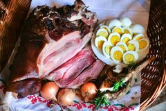 Smoked ham and eggs. Easter menu. Easter ham and eggs. Traditional breakfast. Close up shot of food in wicker basket Royalty Free Stock Photo