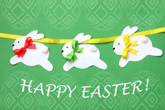 Easter hand made greeting card: festive paper bunny garland isolated on easter egg background Royalty Free Stock Photography