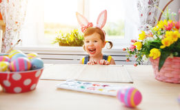 Easter. happy child girl with bunny ears with colored eggs and f Stock Photography