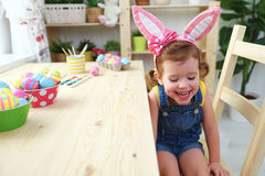 Easter. happy child girl with bunny ears with colored eggs and f Royalty Free Stock Photography