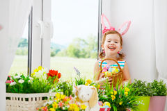 Easter. happy child girl with bunny ears and colorful eggs sitti Royalty Free Stock Image