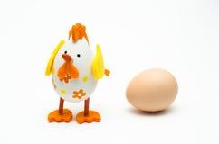 Easter egg vs egg Royalty Free Stock Images