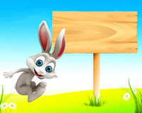 Easter happy jumping bunny with sign. Easter happy bunny jumping with sign