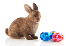 Easter hare with chocolate eggs Royalty Free Stock Image