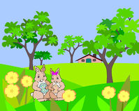 Easter hares in the garden. Royalty Free Stock Photos