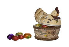 Easter Hen and Eggs. Clay easter hen with chocolate eggs inside and outside with copy space Royalty Free Stock Images