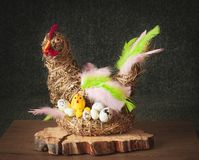 Easter Hen Made of Hay with Eggs and Chicks. Hand-made Easter decoration royalty free stock photo