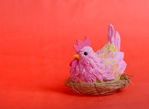 Easter hen. On red background royalty free stock image