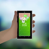 Easter. Hold your hand a smart phone. Illustration Royalty Free Stock Photos