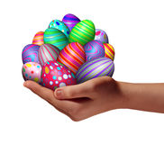 Easter Holiday. Easter egg success as a spring time holiday celebration concept with a human hand holding a group of decorated ornamental eggs found in a Stock Photos