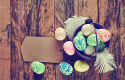Easter holiday background, bucket with multicolored eggs Royalty Free Stock Images