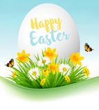 Easter Holiday Background. Colofrul eggs in green grass. And flowers. Vector Royalty Free Stock Image