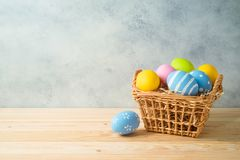Easter holiday background with easter eggs in basket stock photography